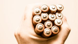 Batteries in the Hand. Mobile Power Supplies in the Male Hand. Power Concept.