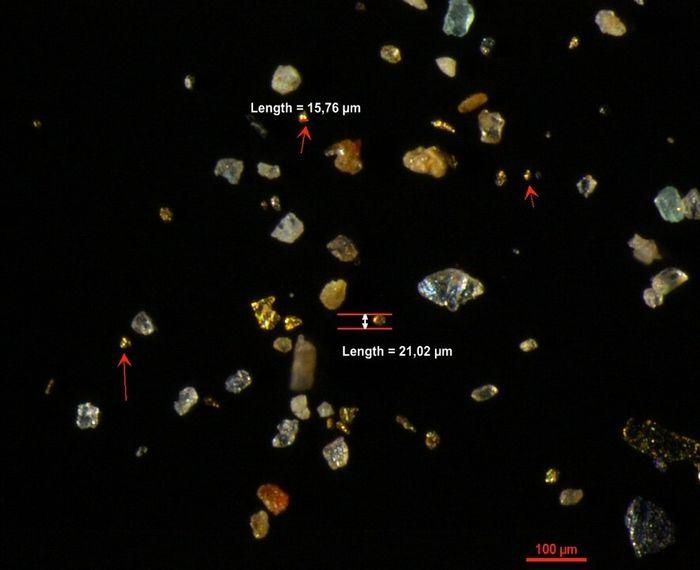 Mikroskopbilde av gullpartikler.