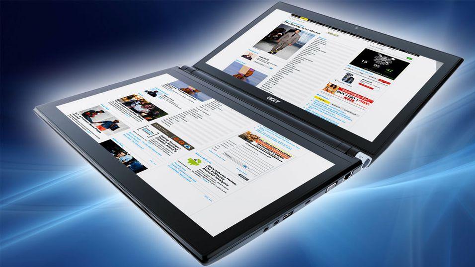 Laptop med to skjermer til Norge